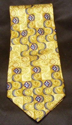 J.Z. Richards Mens Silk Tie Necktie  Print in colors gold, blue, and black. 100 percent Silk 58 inches in length 3.75 inches at it's widest point.
