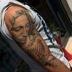 Mother Mary Praying Hands Rosary Tattoo For Males On Arm