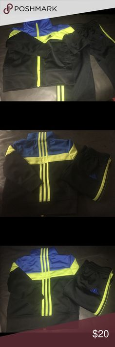 Adidas track suit for boys size 12 months Like new track suit for baby boy. Blue and green. Didn't get much wear out of it before my son grew. Adidas Matching Sets