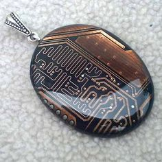 The Blue Kraken creates beautiful jewelry and works of art from recycled circuit boards and other computer hardware. - Page 66