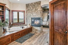 Great fireplace between master bath and bedroom
