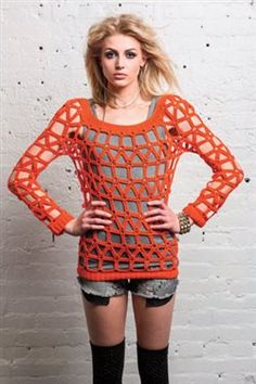 Go There Now Worked seamlessly from the bottom up, this futuristic design is crocheted in the round. The sleeves are crocheted separately and added at the bustline before finishing the sweater. Ribbing at the neck and hems holds it all together. Make it fitted or oversized, then wear it up or off one shoulder. DesignerLinda…