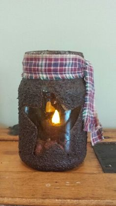 This used to be a jar of peppers.  A little mod podge, coffee grounds, and a piece of homespun, and voila!