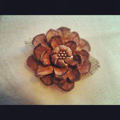 Homemade flowers.. Pinecones and burlap