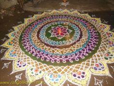 2014 Adyar competition kolam Here four steps of sikku [kambi] kolam has done like circle and finished with wonderfull flower colour kolam .its totally different concept of rangolikolam Kolam Rangoli, Simple Rangoli, Rangoli Designs, Colorful Flowers, Beach Mat, Art Projects, Mandala, Outdoor Blanket, Vibrant