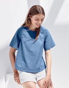 A J.Crew women's top with a story. This swingy silhouette (made in a special indigo herringbone fabric from Spain) was inspired by a vintage top from the '70s that our designer found at a flea market in Brooklyn.