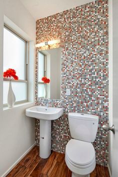 Mosaic wall tile on the back wall of the powder room dyi