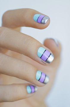 light blue, lilac, and metallic silver color block nail art w/ black stripes separating the colors