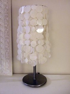 """Faux capiz shell lampshade tutorial - laminated white rice paper cut into 1"""", 1 1/2"""" & 1 1/2"""" circles & sewn together in 18 circle lengths & hung over top lamp shade ring - easy peasy!"""