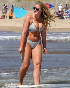 Wow factor: Size 14 model Iskra Lawrence works her incredible curves in grey cleavage enhancing cut out bikini at The Beach House in New York