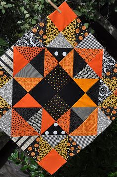 Halloween quilt top, made with HSTs and a four-patch center,  by Pleasant Home. The pattern is Evening Star from Pieces From My Heart.
