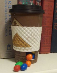 There's always coffee! Link: http://www.instructables.com/id/Secret-Coffee-Cup-Candy-Dispenser/
