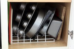 Brilliant way to organise bakeware!! (The whole page on her kitchen organisation is a must-see, really...)