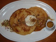 """These semolina pancakes are known as beghrir, which means """"1000 holes"""". The name refers to the multitude of holes that develop on the surface as they cook. The beghrir is very common in the Middle East for ages and Jews from Arab origin are known to 'imported' this recipe since the creation of the State of Israel. Before that time, the Canaan used to make the semolina pancakes as well."""