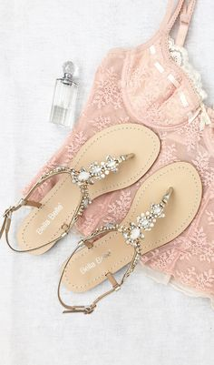 - Thong sandal - Vintage-inspired rows of crystal jewels and white onyx-like stones - Jewels set on gold metal plate - Light blue outsole for your 'something blue' - You can rewear them as dressy sand