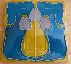 Great colour way used for this English Art Nouveau design from Johnson c1906/9 see tile reference 403 to see a red and blue colour way in the book Art Nouveau Tiles with Style.
