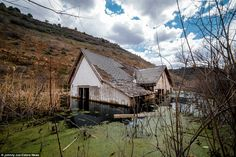 An abandoned home in Thistle, Utah, that has sunk into a pond. During April of 1983, a massive landslide took out the entire town, washing it downhill. It has been said that a family had been trapped within this home during the time it sank, and one person was not lucky enough to make it out