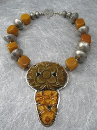 Carved Bakelite in Sterling with African amber and silver