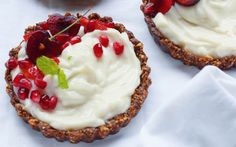 <p>The crust is a chocolaty and nutty combination of dates, almonds, cacao, and mulberries, which are then topped with some sweet coconut yogurt and cherries! </p>