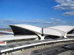 """Dubbed the """"Grand Central of the Jet Age"""" by critic Robert A.M. Stern, Eero Saarinen's curvaceous TWA Flight Center was a paean to the romance of flight. The sloped concrete roof recalls two flapping wings, while contours constantly bend and flow into each, creating a fluid collection of terminals, staircases and forms. After being shuttered for years, the space has been turned into a luxury hotel. #dwell #moderndesign #modernarchitecture"""