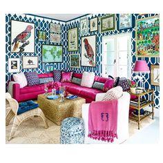 Beautiful living or sun room. Pink, royal blue, birds & bright accessories. Dramatic couch.