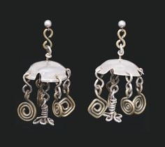 alexander calder, earrings, 1938. ,metal champagne caps and wire