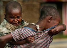 There is no fucking need for wars. We never get to see the true consequences of it.    In this November 6 photo, Protegee, carrying her sibling on her back, cries as she looks for her parents in the village of Kiwanja in eastern Congo