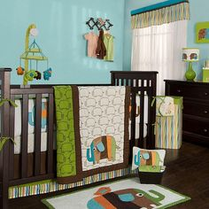 Hez and Ty DECIDED FINALLY on a set and this is it.  I am ordering the main set lamp/shade/pillow & Mobile...but there are a lot of pieces to go with this...hint hint    Kidsline Zutano Elephants Baby Crib Bedding Collection at SimplyBabyBedding