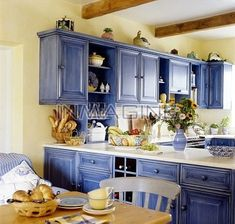 The cabinets - I don't really like the aged look, but this is the tone I think I like. Would look good with cobalt blue and yellow.
