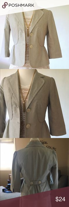 the limited peplum blazer Adorable blazer from The Limited. Waist length with a peplum hem. Light brown and ivory pin stripes. 3/4 length sleeves and 2 buttons. Size 8. Excellent condition with the exception of a feint dark mark near the collar tag, as pictures. /blazer, jacket, coat, suit, top, stripes, stripped, pinstripes, limited / The Limited Jackets & Coats Blazers