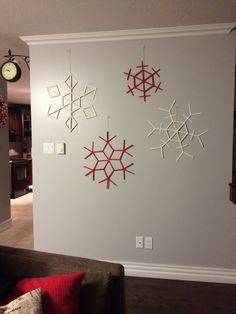 Popcycle stick, Red and White paint, GLITTER!, Glue Gun and lots of Fun!! Homemade Snowflakes under 10$