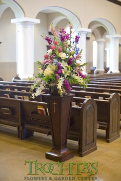 A floral arrangement at the beginning of the aisle. Could be a smaller form of what is on the alter. Photo by Sherry Lynch