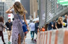 A plaid belted shirtdress is worn with a crossbody Saint Laurent satchel