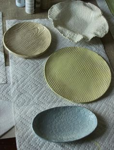Decorative plates - air dry clay pressed against textures/ molded into shapes/ painted /clear varnish