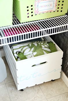 Pantry floor storage - crate on castors: I like this idea for a prettier look, maybe for aprons and extra hand towels