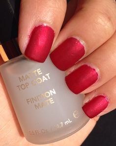 Matte cherry red nails.