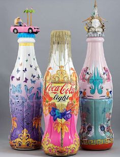 """Coca-Cola // Donatella Versace  """"It's been fun to create a pattern to dress-up a Coca-Cola light bottle. Thinking about Coca-Cola I focused on its sparkling bubbles, which I converted in lots of jellyfish, but the Versace jellyfish!""""."""