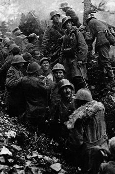 Captured Italian soldiers are escorted to the rear by German soldiers during the Battle of Caporetto, 1917.