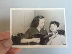 Black and White picture of woman musical instrument, vintage photograph of woman mandolin, picture of mother and son, black & white photo
