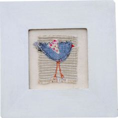 A bright little bird to adorn your walls and bring a splash of colour to your home. Using recycled denim and a cute little floral heart all embroidered together in a frame. There's a range of these little birds for you to collect.