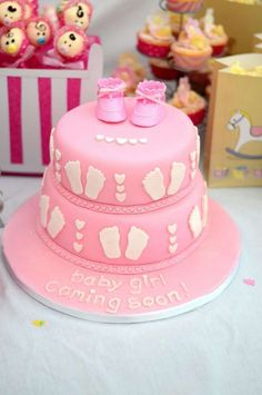 Pink cake at a sugar and spice girl baby shower party! See more party planning ideas at CatchMyParty.com!