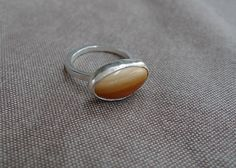 Desert Canyon Lost & Found Stacking Ring.  I love how the rusty orange fades to a nice sandy colour. It reminds me of my wonderful trip to the Grand Canyon last year. The stone is a kind of organic cabochon cut, set in a silver bezel setting.