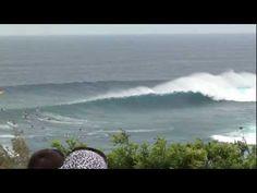 Paddling a big swell Peahi, Maui.