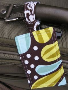 These custom fabric luggage tags would make a useful little gift for any friends, family, co-workers or teachers that travel. They are also a great way to use up some fabric scraps. Handmade Custom Fabric Luggage Tag Tutorial To print name and address on fabric, cut white muslin and freezer paper 8 1/2″ X 11″. Iron shiny side of freezer paper to back of fabric. Send paper through an ink...