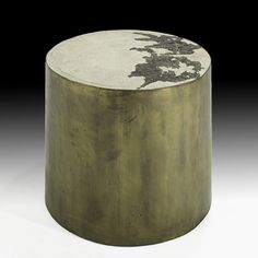 Bronze and concrete stool looks amazing. A very unique combination of elements, this piece would be a prize possession for any astute designer.