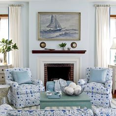 The blue and white palette of this Bermuda sitting room is both formal and approachable, and gets a surprise shot of seafoam via a painted coffee table. Designer Meg Braff anchors the space with vintage nautical artwork, powder blue walls, and British-ins