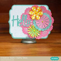 Hello Card - Scrapbook.com - Bright, happy colors on this Hello card. Flowers are cut with an electronic die cutting machine.