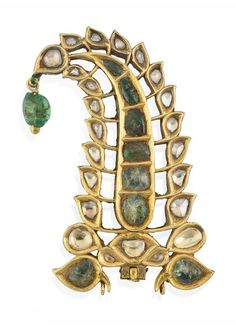A DIAMOND AND EMERALD-SET GOLD TURBAN ORNAMENT (SARPECH)  NORTH INDIA OR DECCAN, 19TH CENTURY  In the shape of a rising palmette curving at top towards the left, a floral bud and petals at its base, an emerald pendant hanging at top, the reverse enamelled with red flowers and green leaves on white ground, a crane with its head turning backward decorating the base of the palmette, the sides enamelled, some flaking