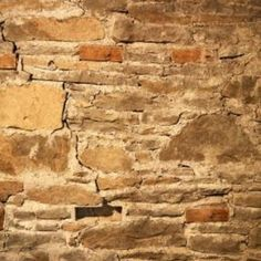 Fill in any cracks with prepared masonry patch before sealing you walls.