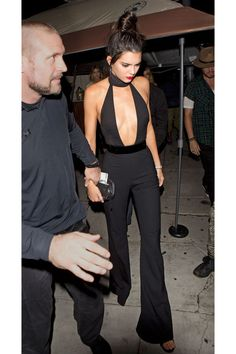 Kendall Jenner in a black cutout jumpsuit at her 20th birthday party